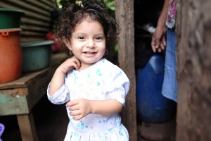 Lupita, Joel's beautiful daughter, watches us walk to and from the supply shed