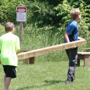 two boys carrying 4x4 beam