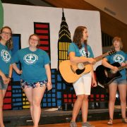 vbs living waters leaders standing on stage