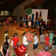 young people gathered in church for vbs